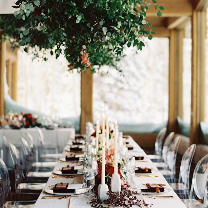 table with greenery chandelier
