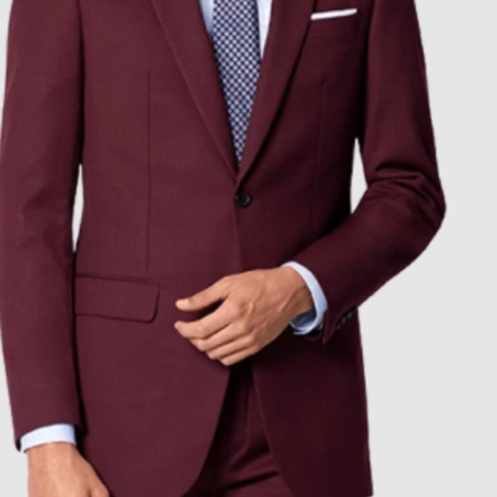 burgundy suit with colored tie