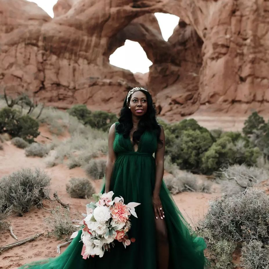 Bride in emerald green wedding dress in canyon