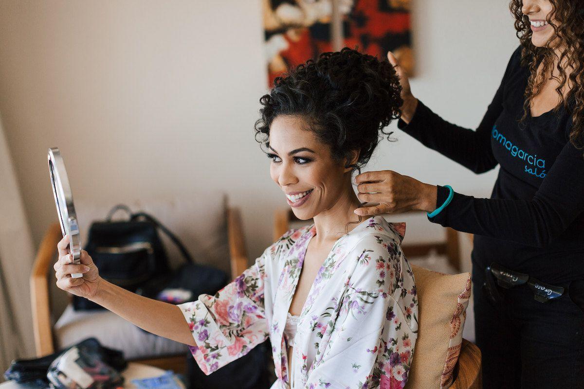 bride looking at hair