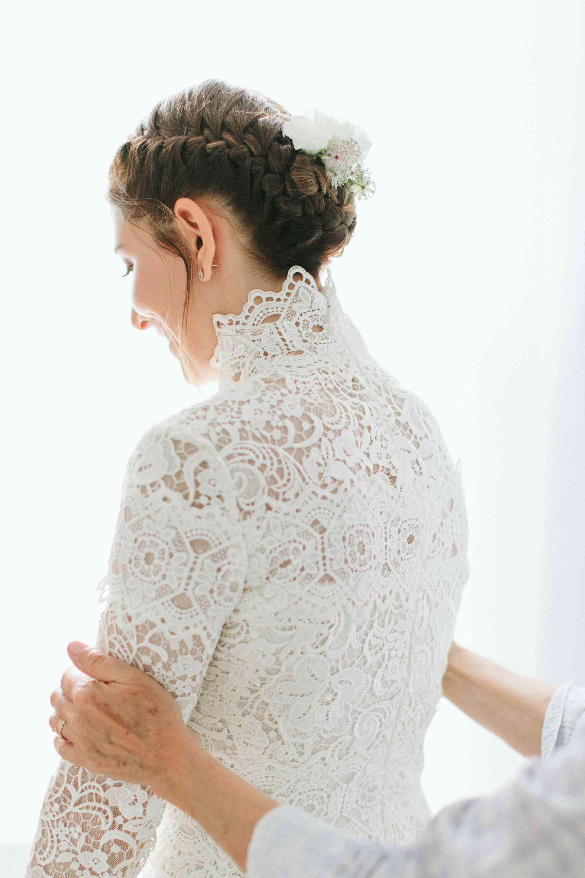 <p>lace wedding dress halo braid hairstyle</p>