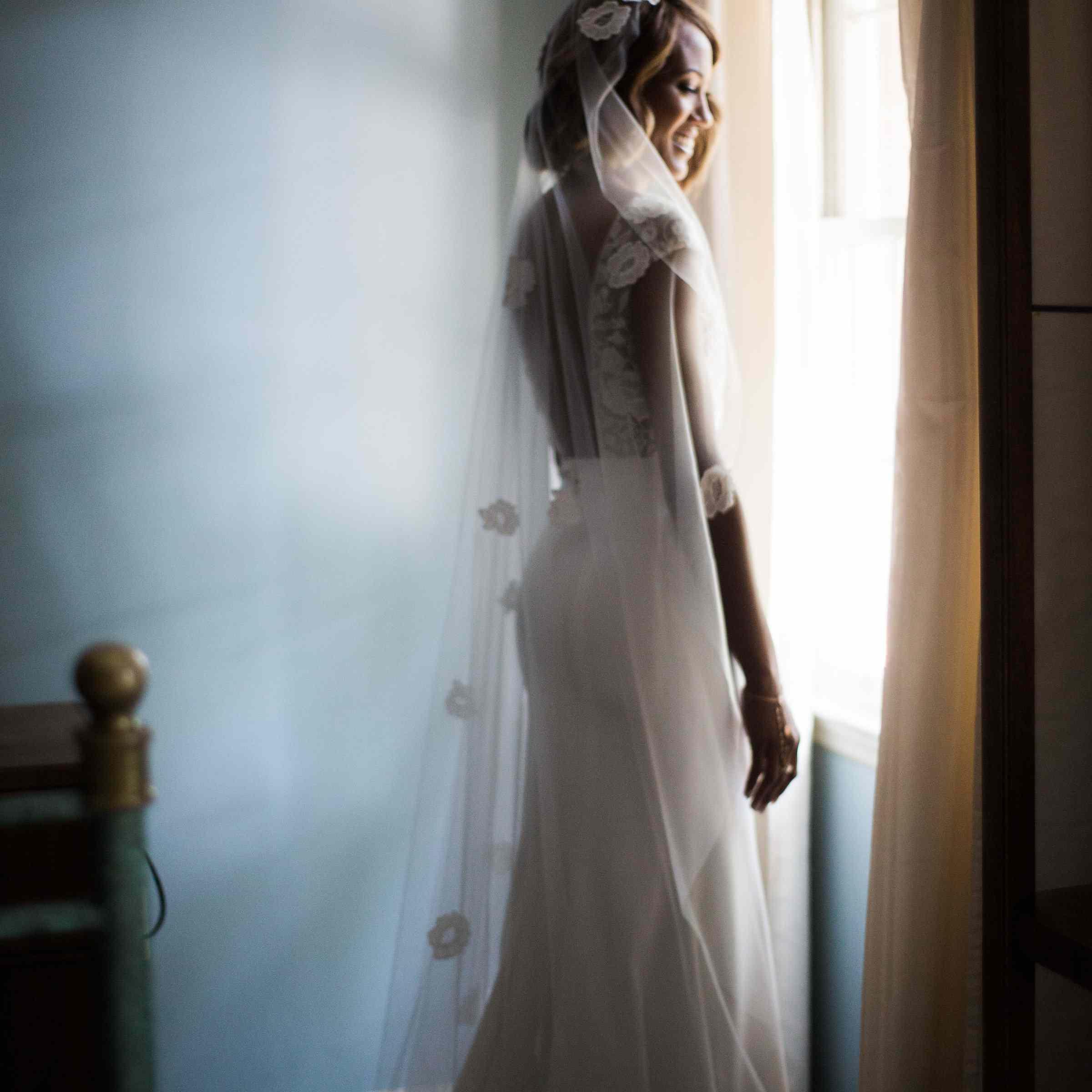 Bride in window with veil