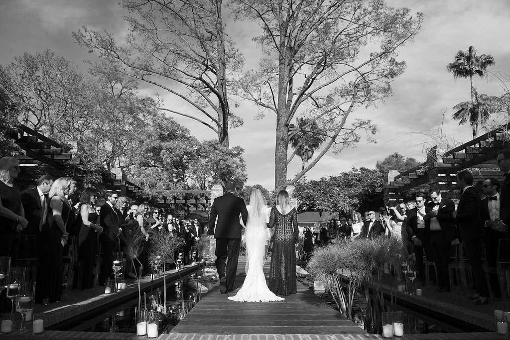 minimalist california wedding, parents walking bride down aisle