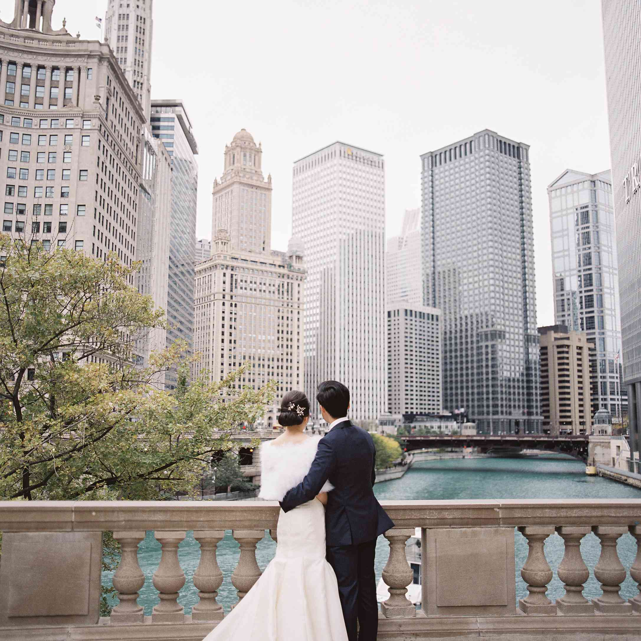 Newlyweds looking at Chicago skyline