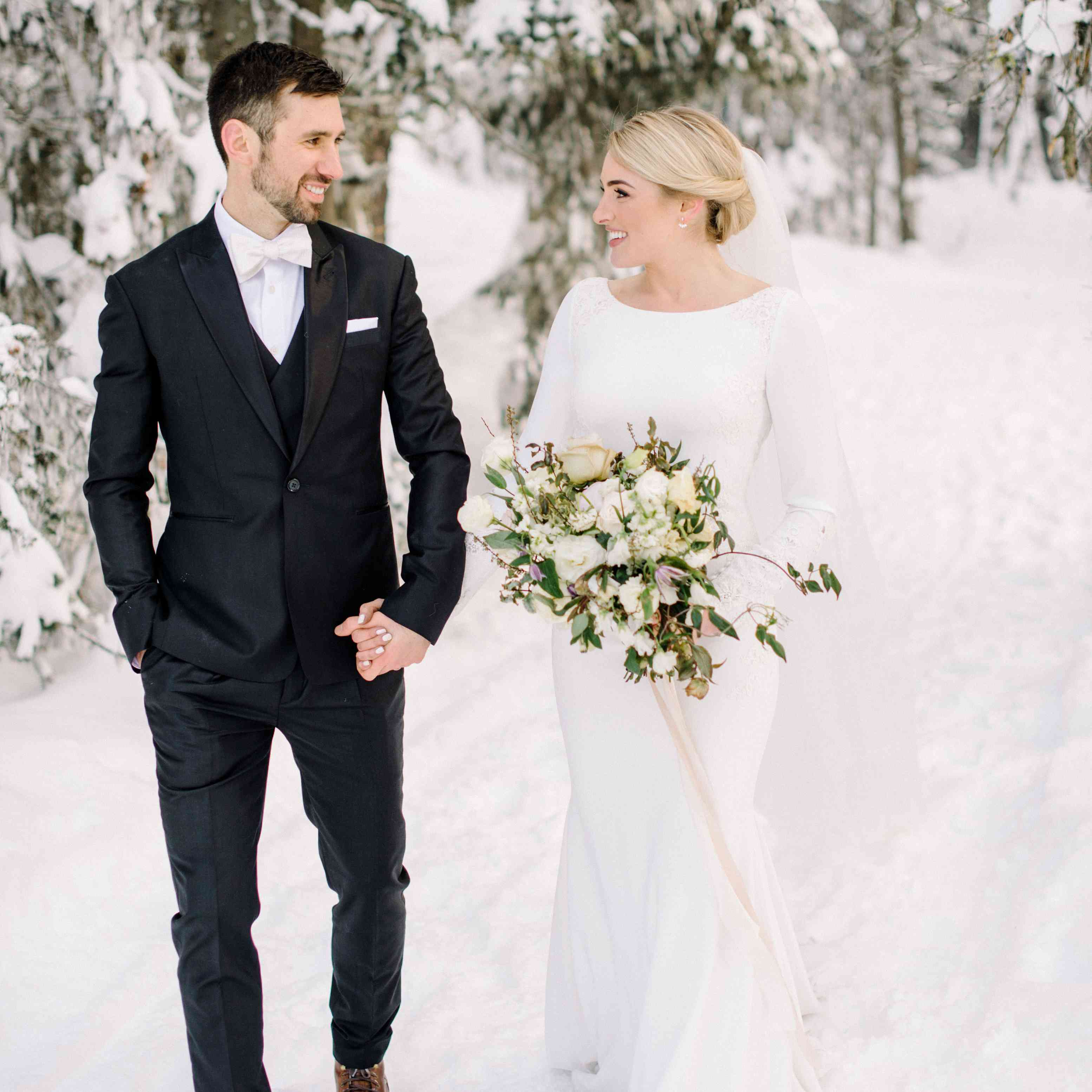 bride and groom snowy mountain background