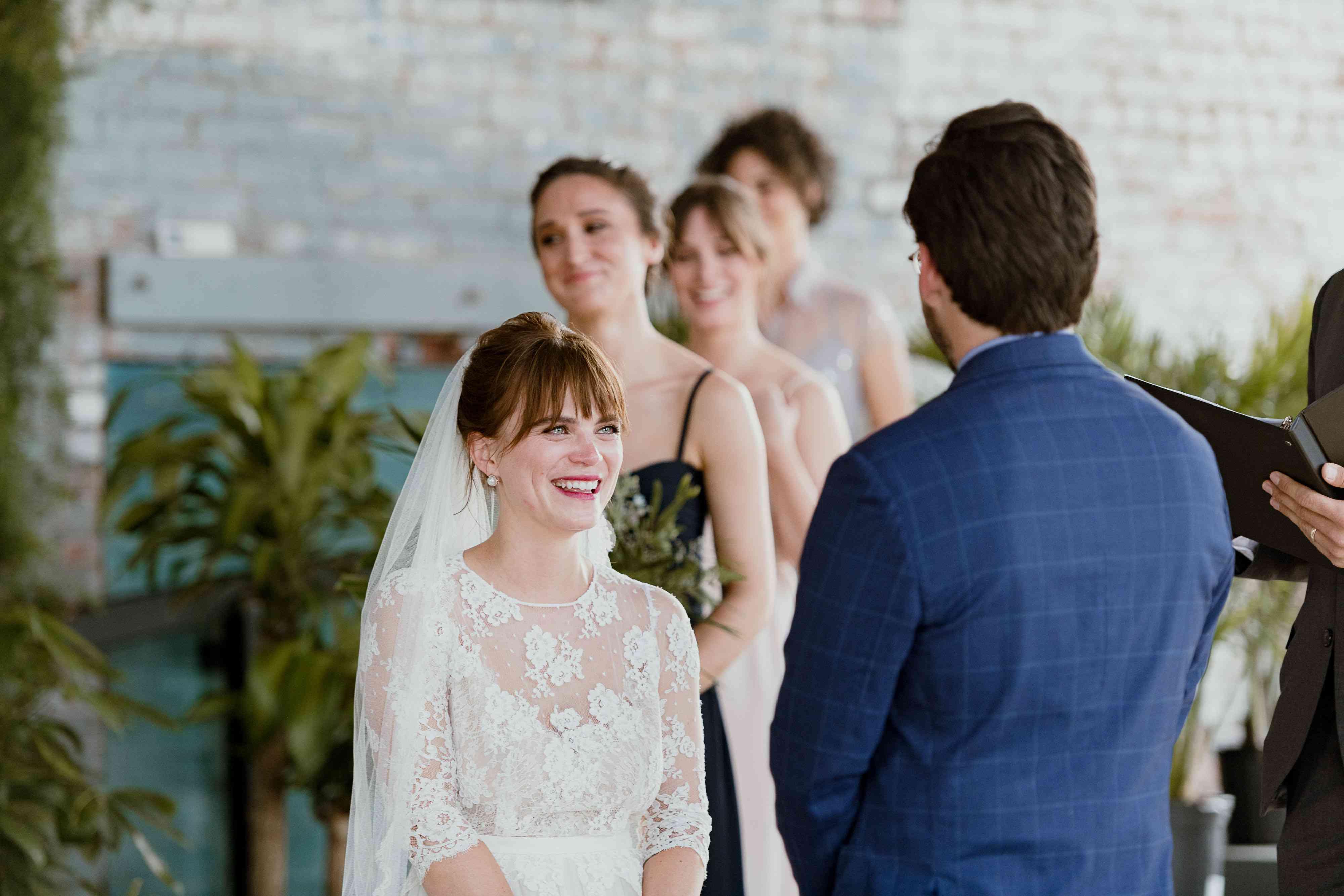 <p>ceremony bride smiling</p><br><br>