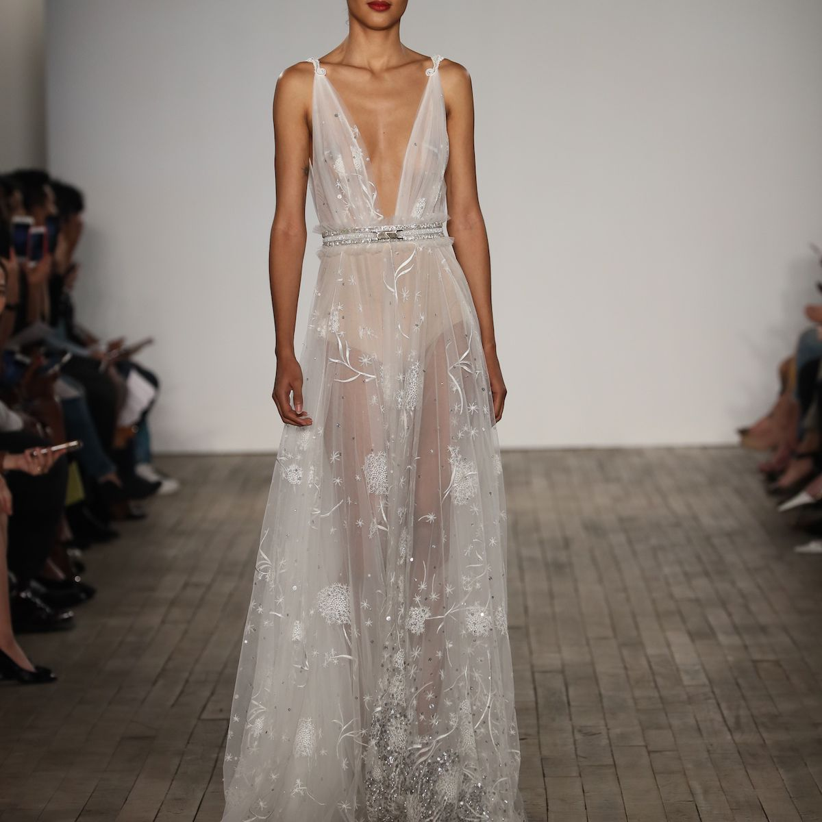 Model in deep V-cut embroidered wedding dress