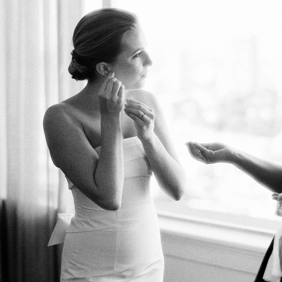 bride getting ready wedding earrings