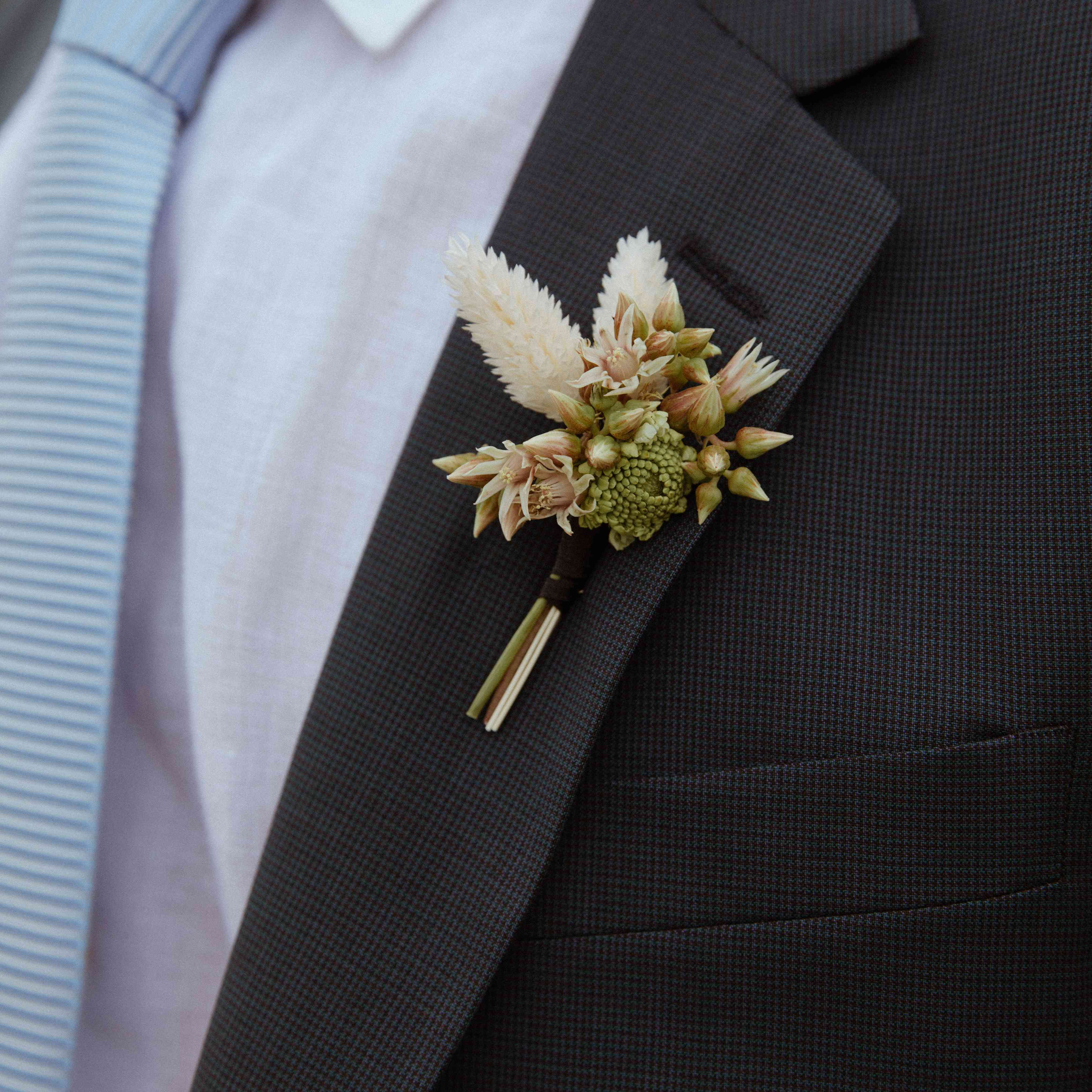 Pieris and dried grasses boutonniere