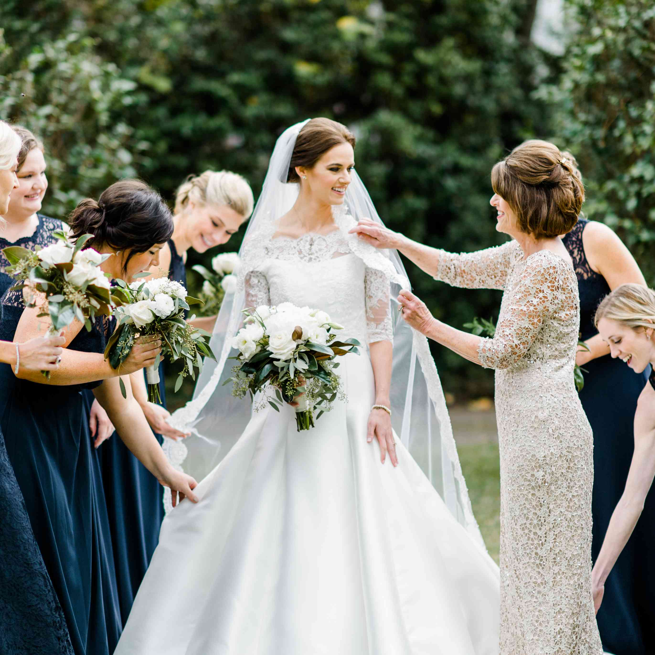 Bride in Wedding Dress with Quarter-Length Lace Sleeves