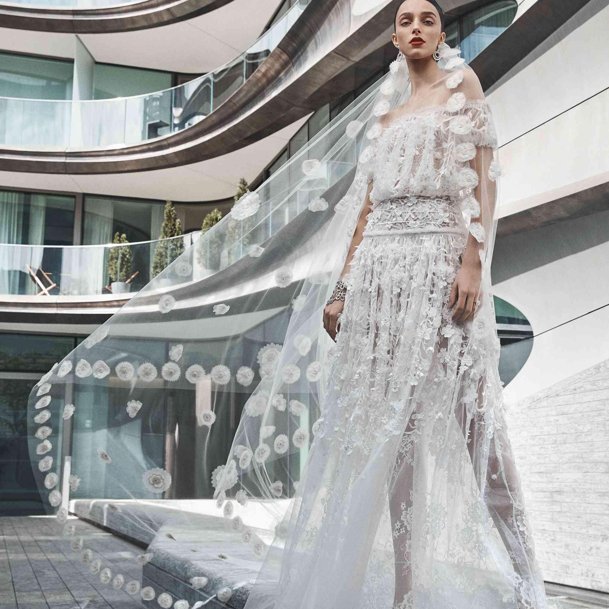Model in off-the-shoulder floral gown