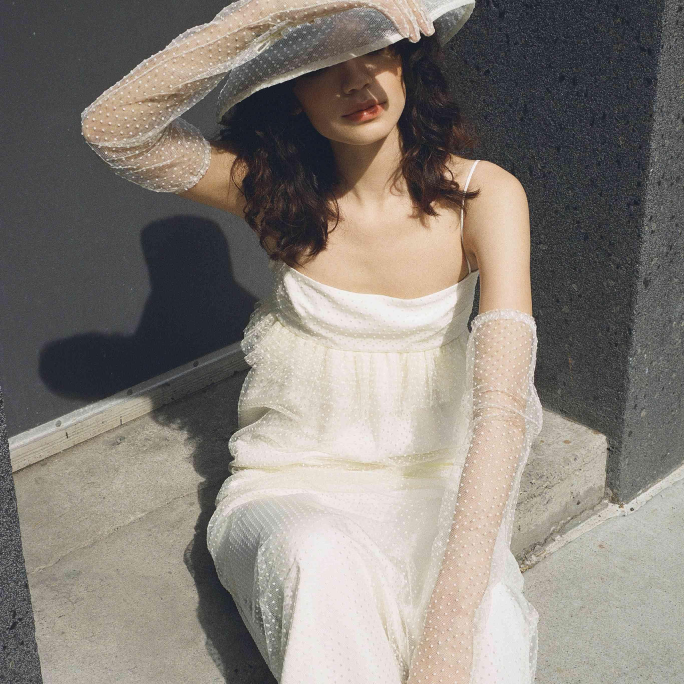 Model in ruffled slip wedding dress