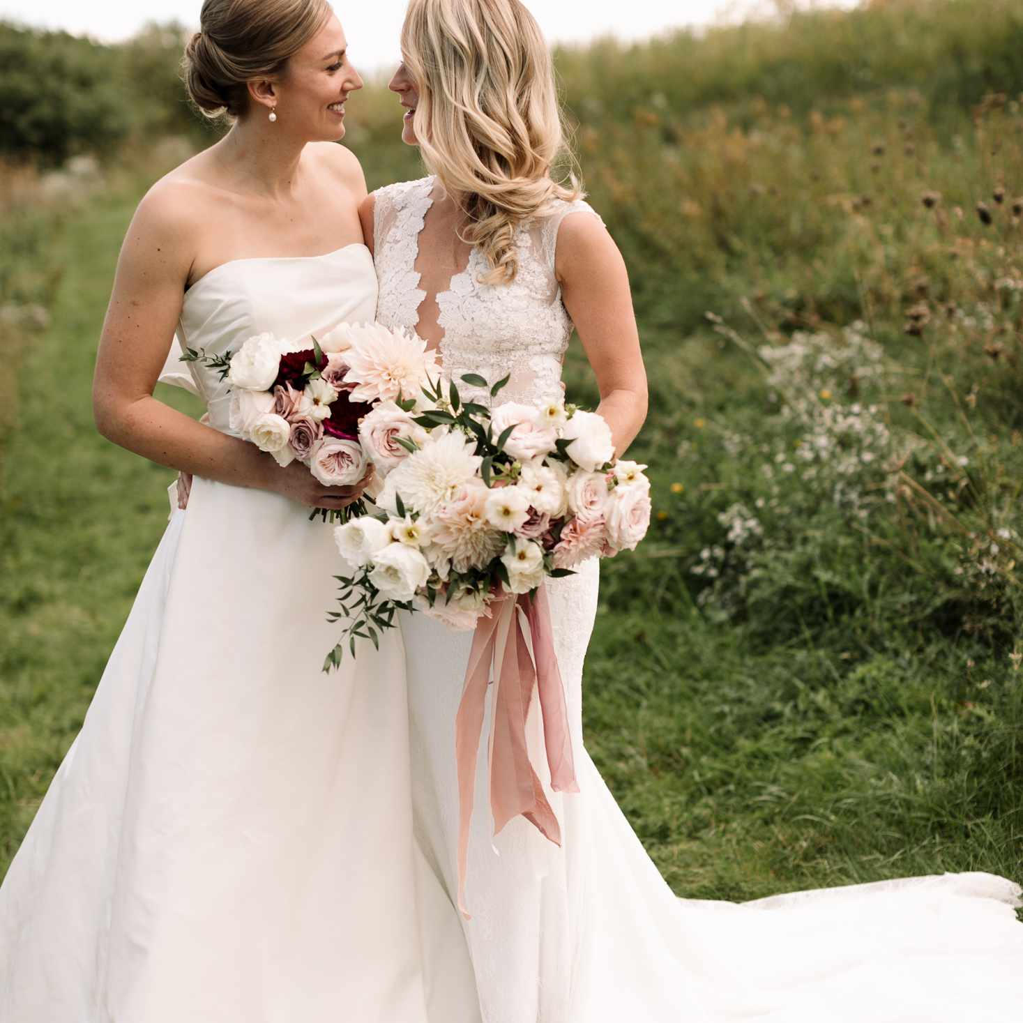 Matching bridal bouquets filled with dahlias and roses