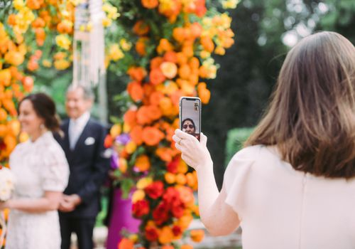 woman facetiming wedding ceremony