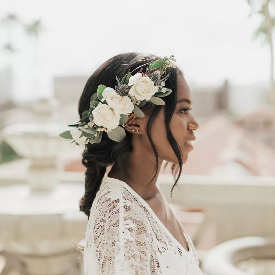Bride with loose fishtail braid and floral headpiece
