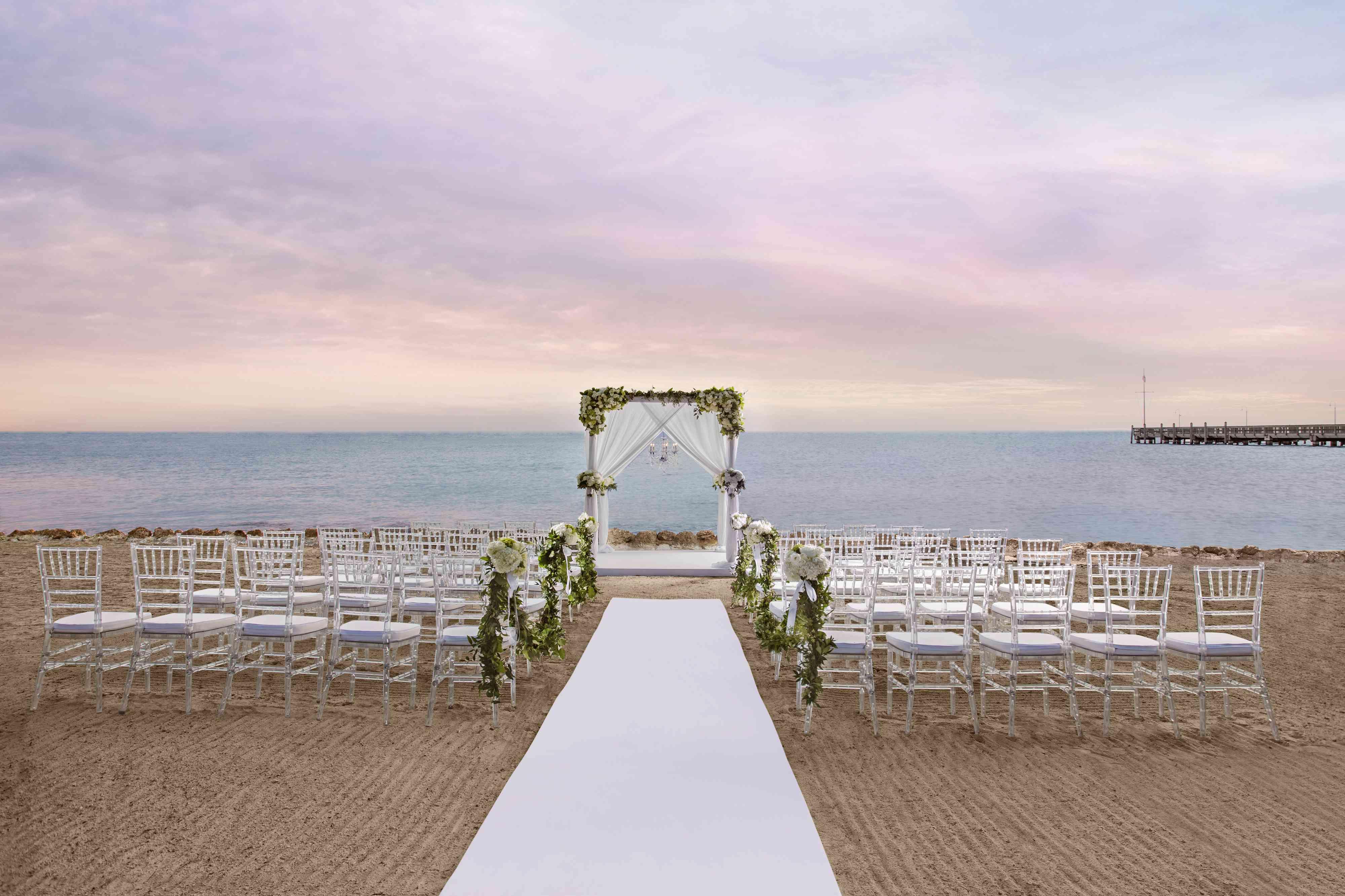 Intimate wedding on the beach at sunset at Casa Marina Key West