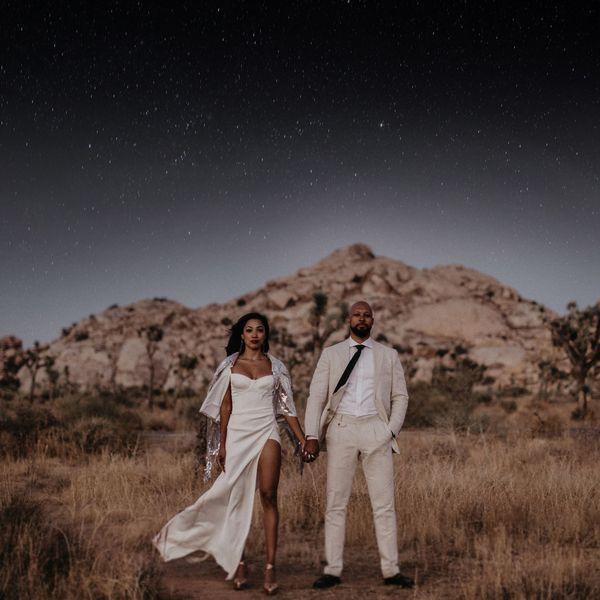 couple standing under night sky