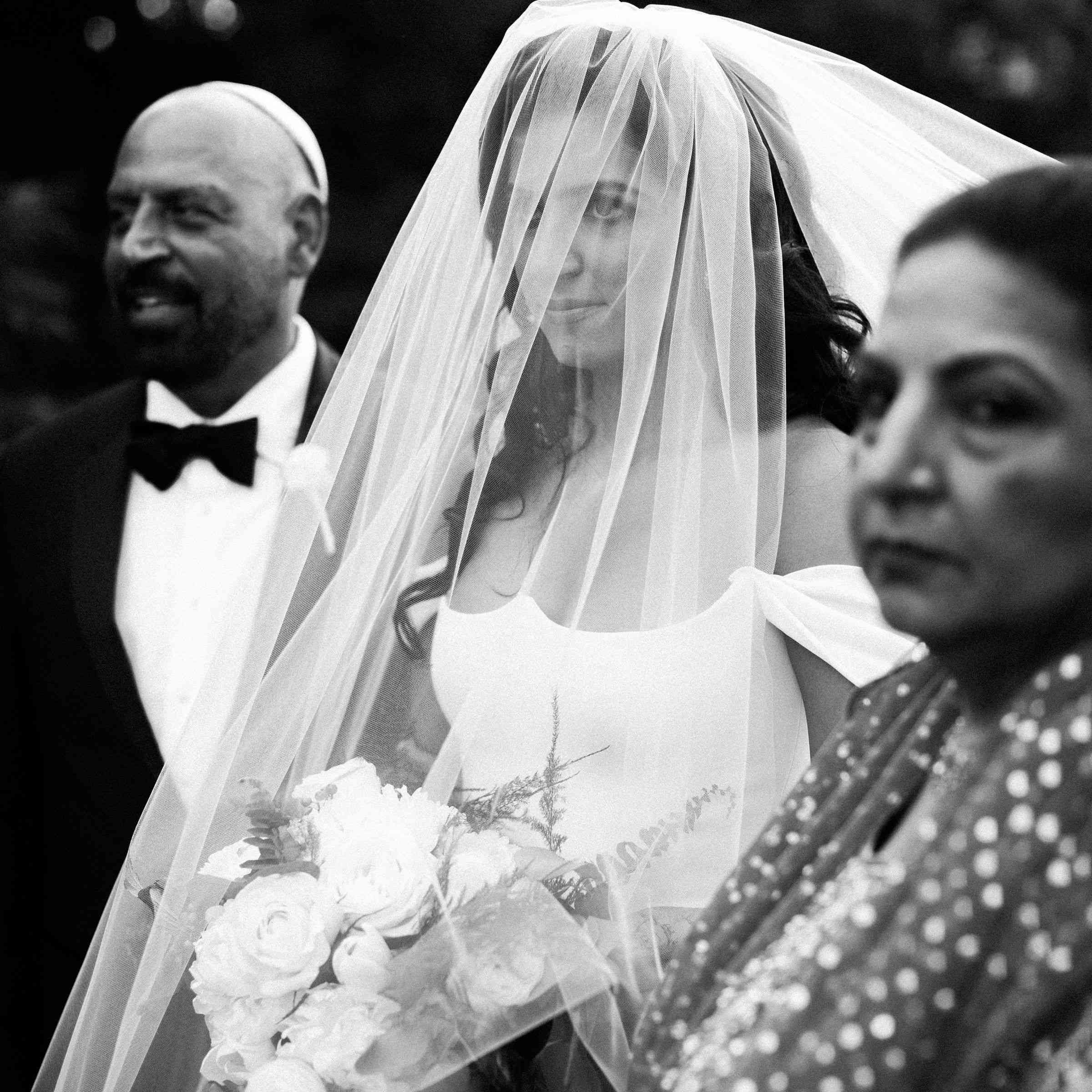 Bride with veil and parents