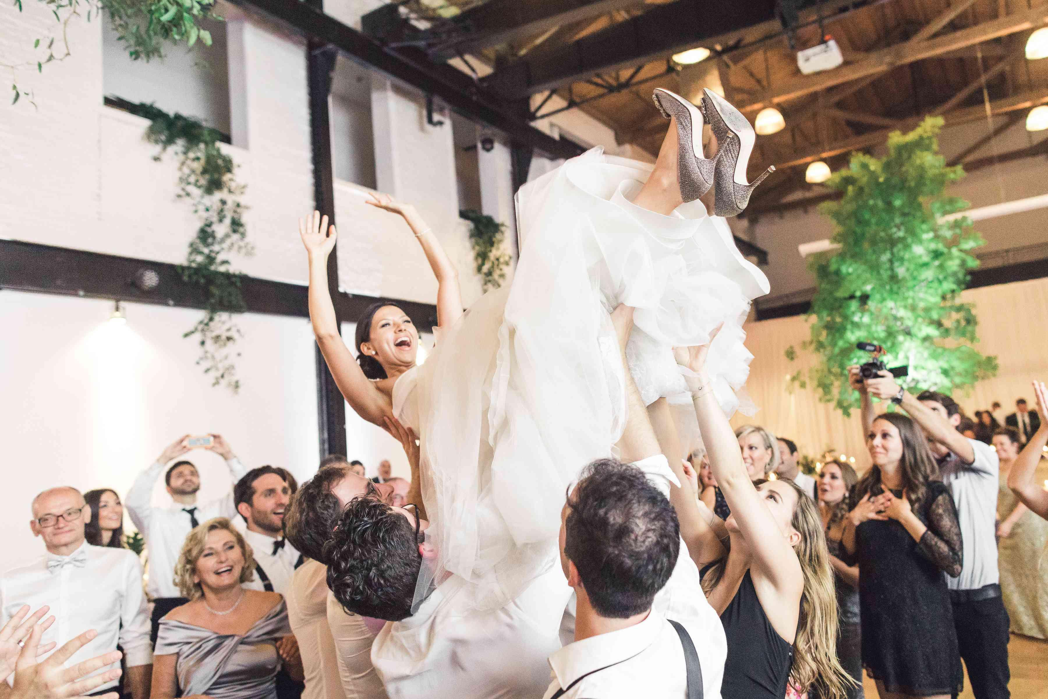 Bride being held up in air