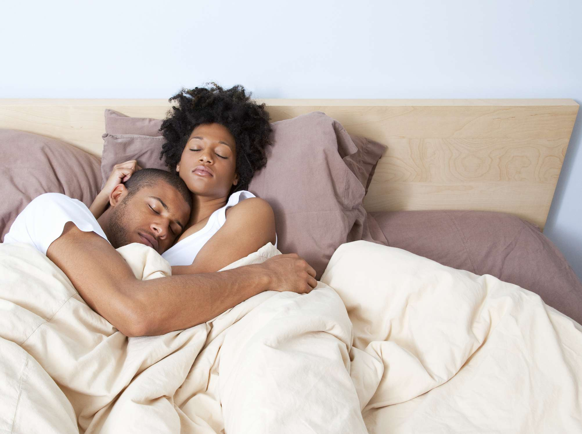Couple in bed taking a nap
