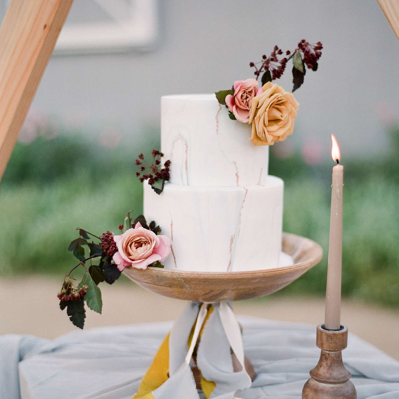 Two-tiered marble wedding cake with floral accents