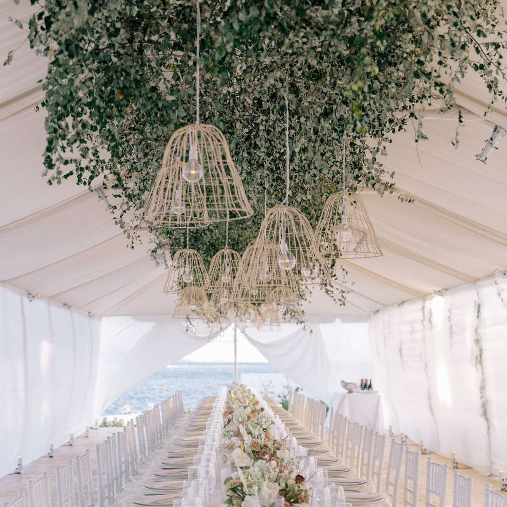 tented reception table with greenery