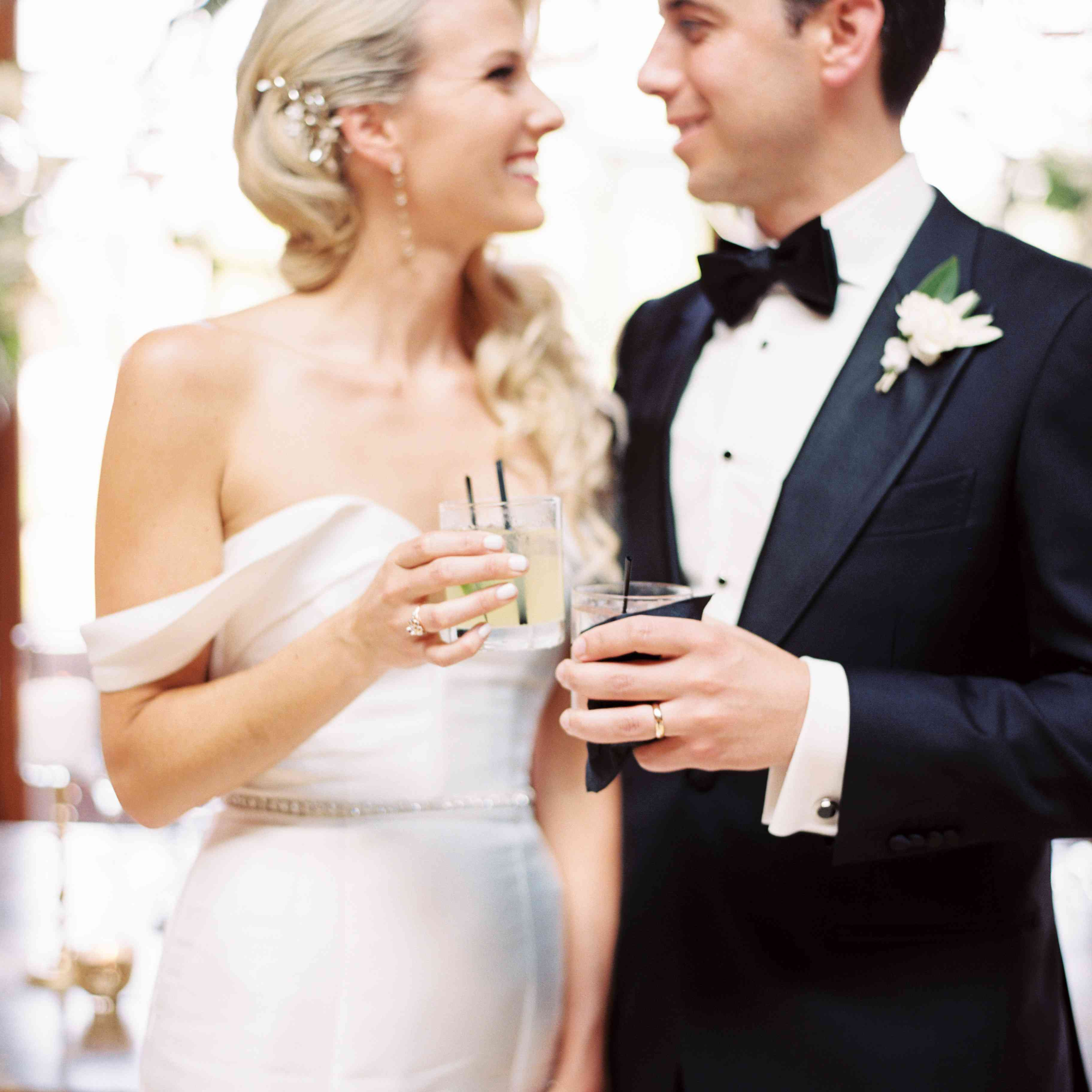 <p>Bride and groom cheers</p><br><br>