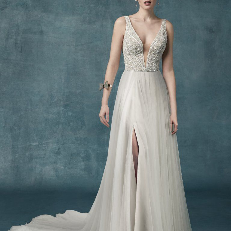 18 Wedding Dresses With Elegant Pearl Detailing