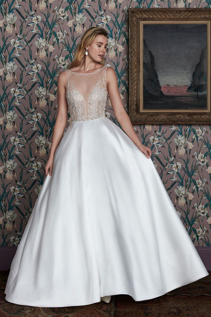 Model in wedding ball gown with embellished top