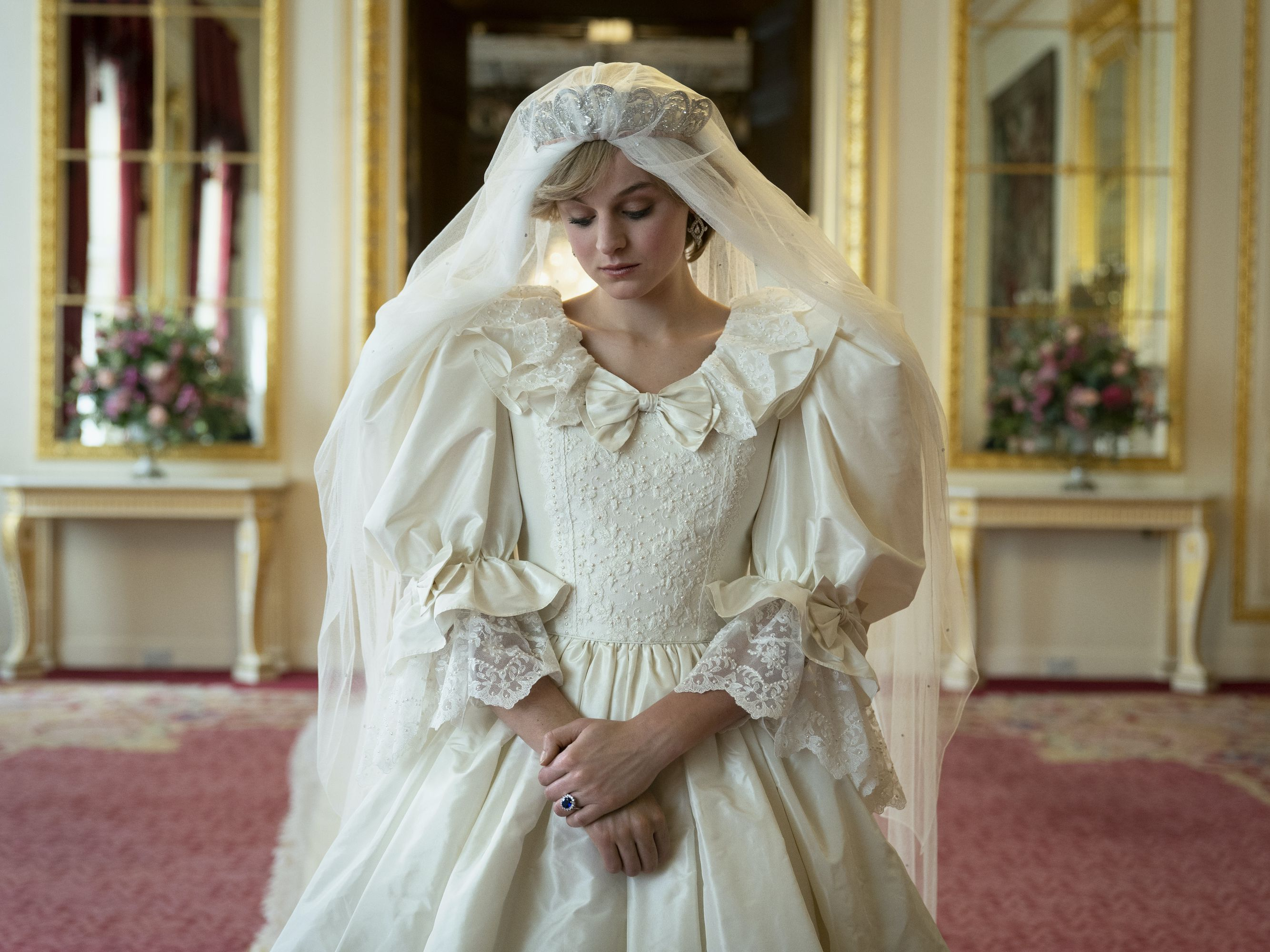 stars of the crown spill on recreating princess diana s iconic wedding dress brides