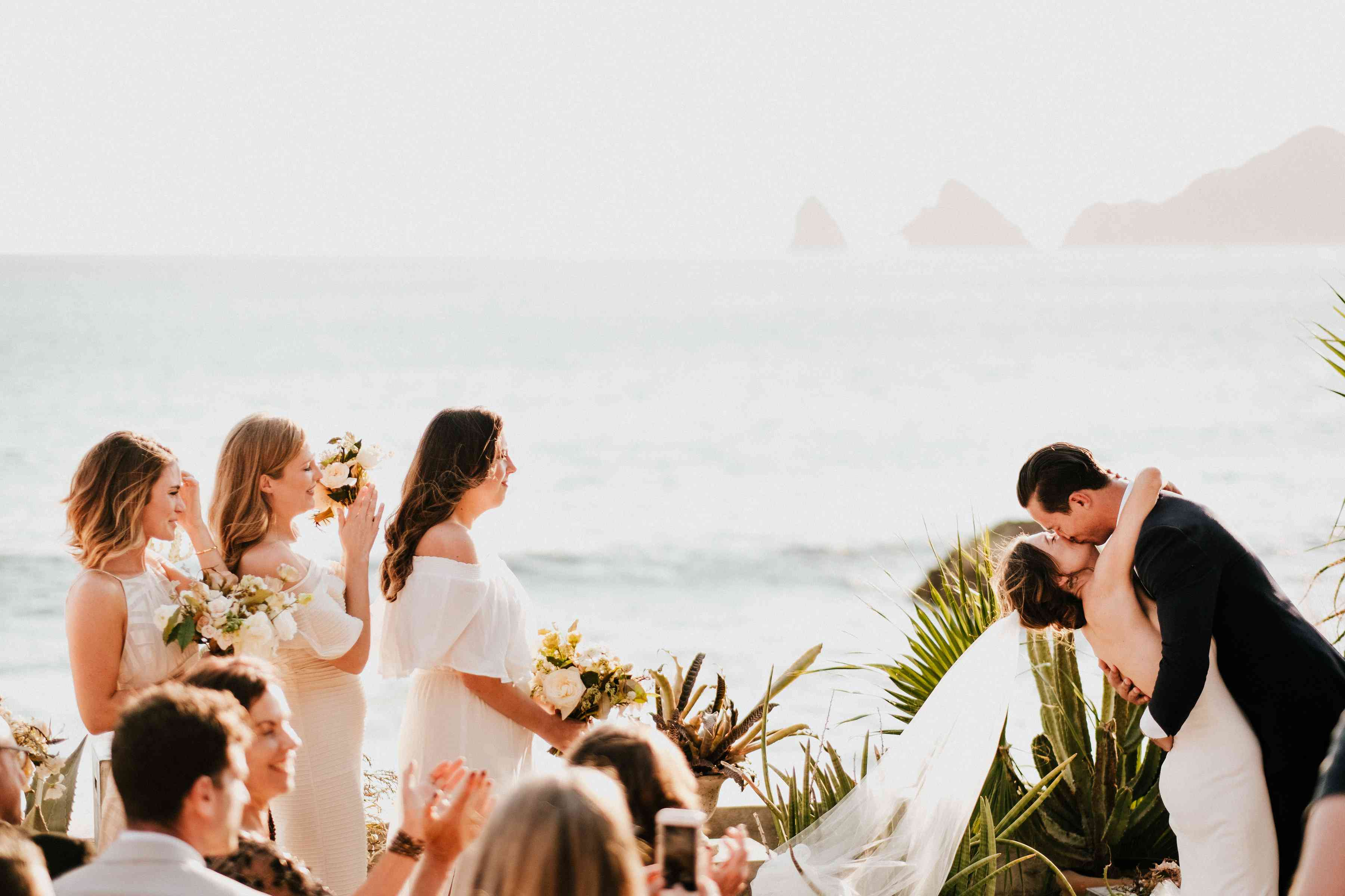 Bride and groom kissing during ceremony