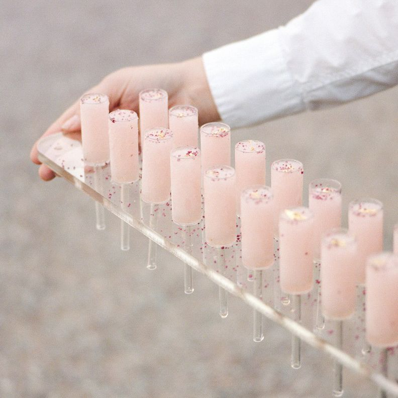 Caterer holding a tray of Frosé drinks