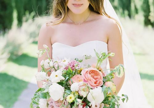Bride looking down holding a bouquet