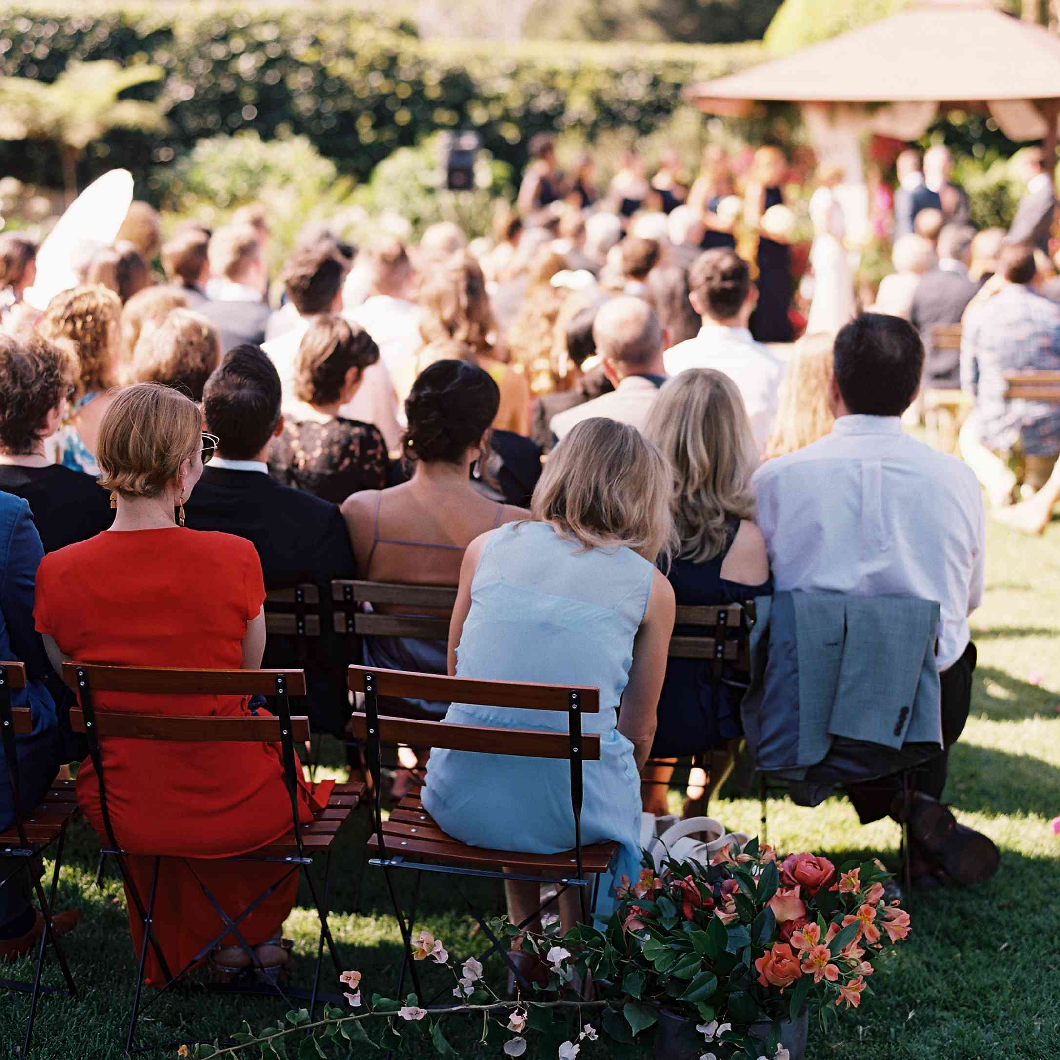 Guests watching wedding ceremony