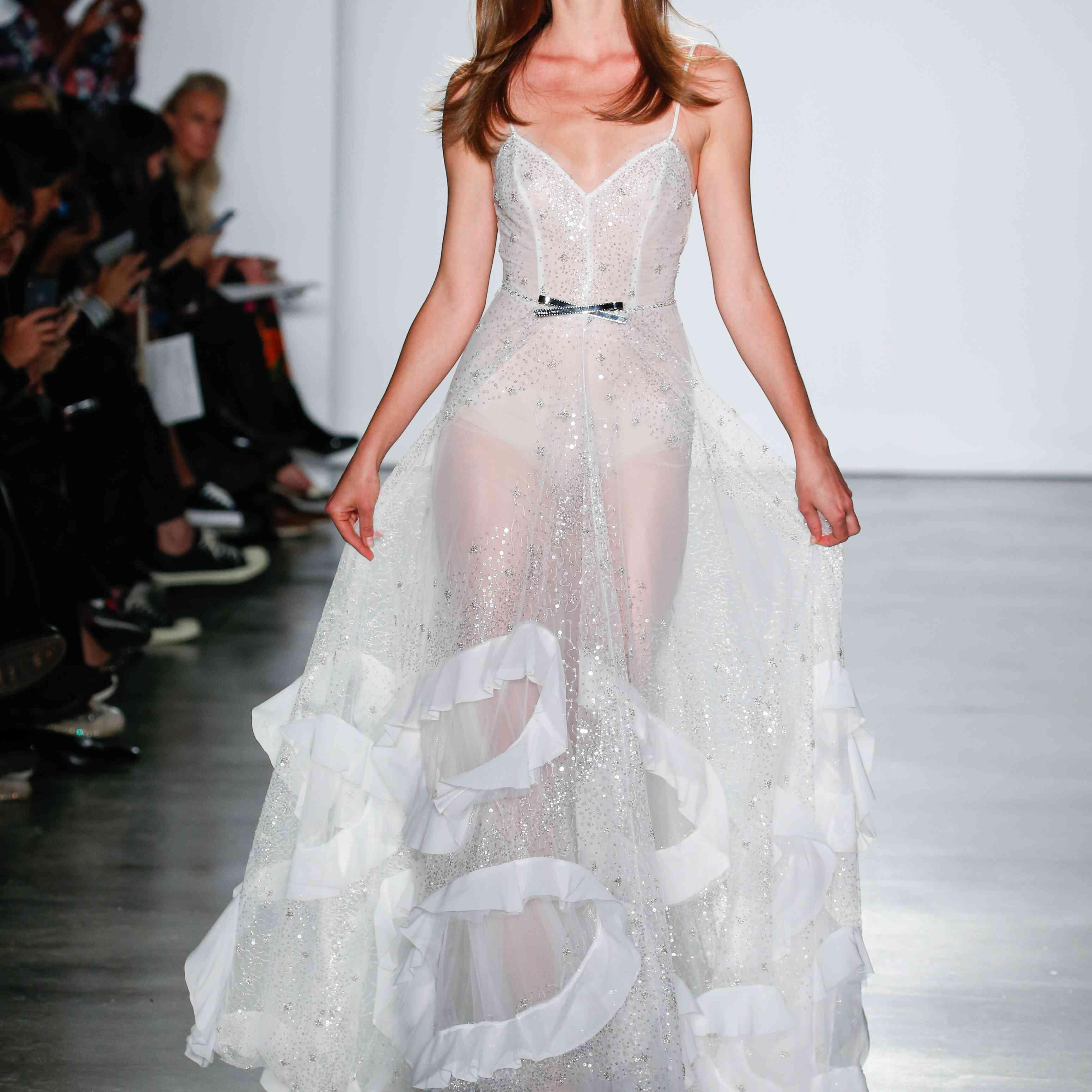 Model in spaghetti strap wedding dress