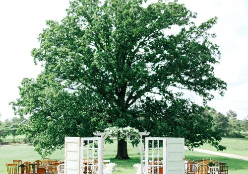 Vintage ceremony doors in front of a large tree