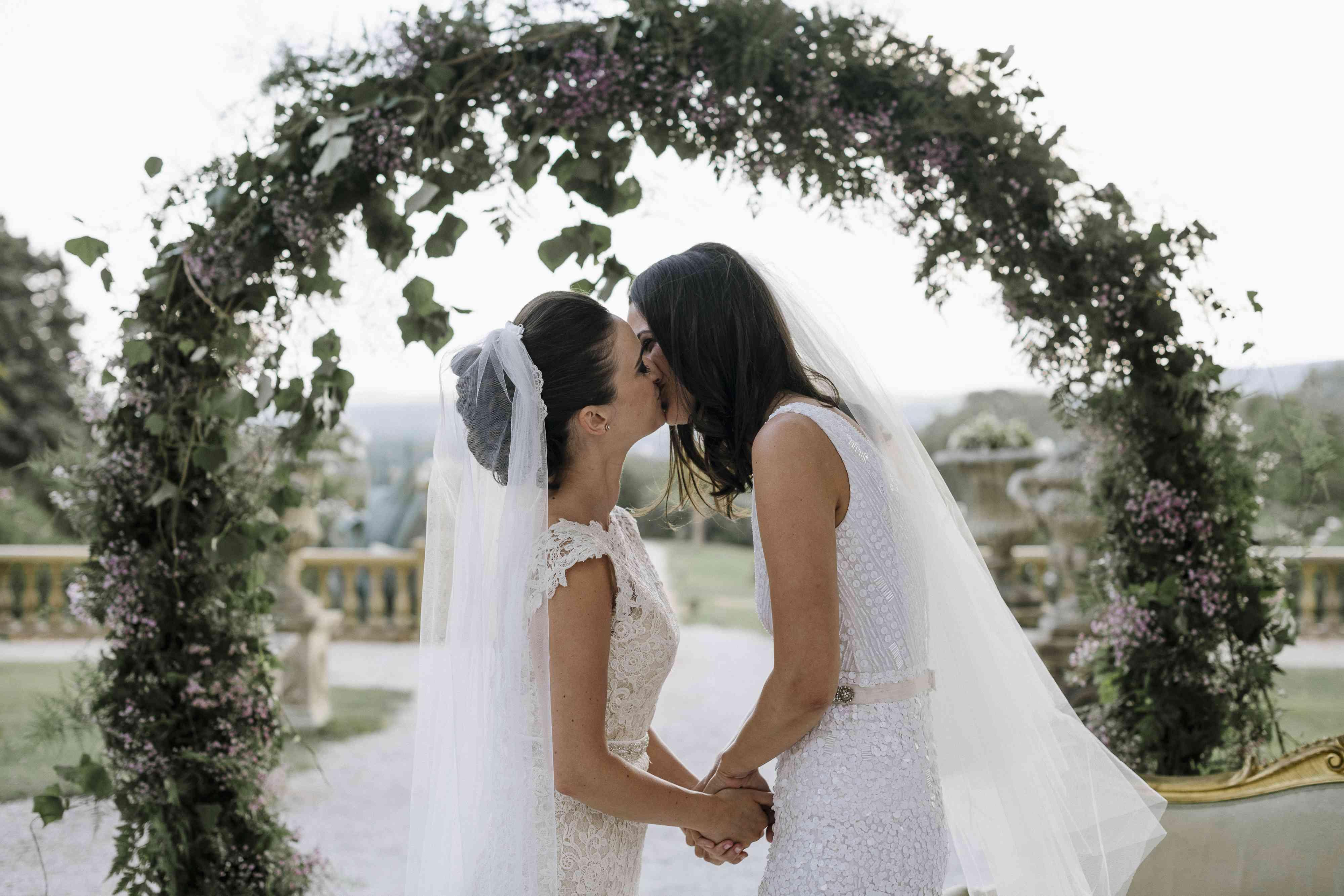 <p>brides kissing wedding ceremony</p><br><br>