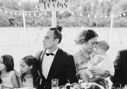 <p>Bride and groom with their kids.</p>