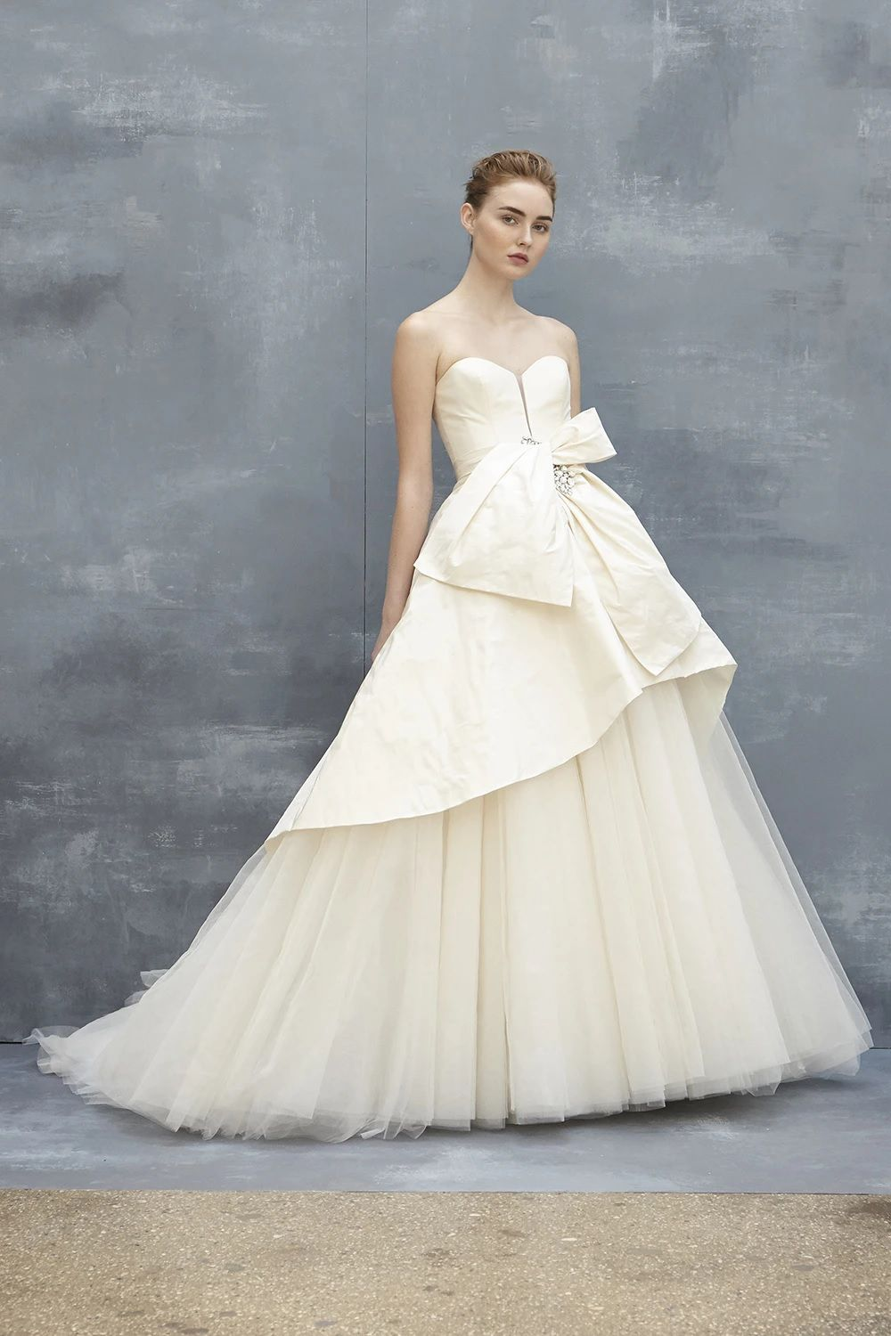 Model in off-white silk taffeta and tulle ball gown