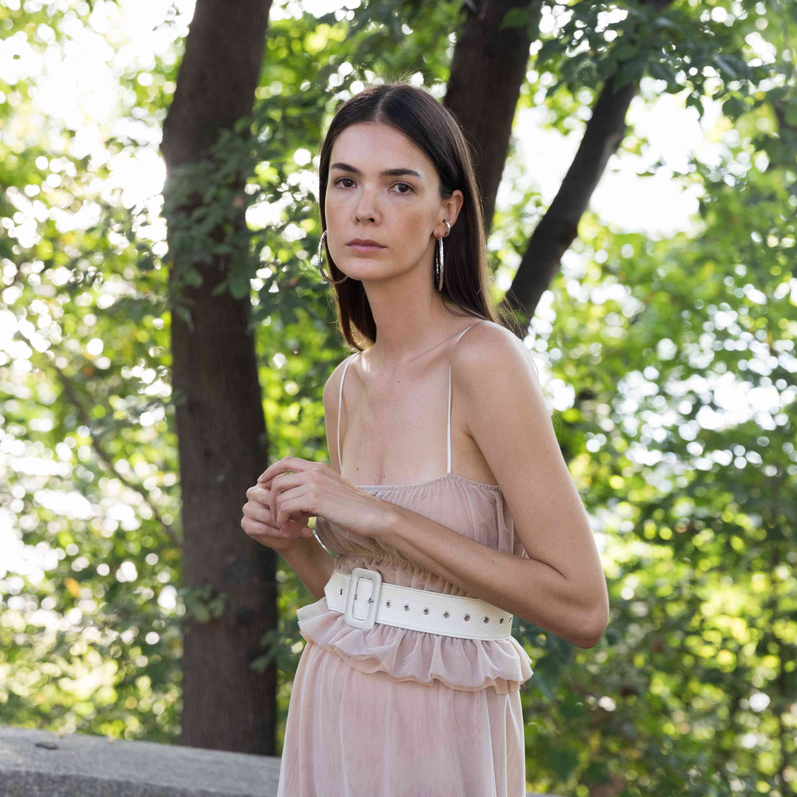 Model in smocked blush top and skirt