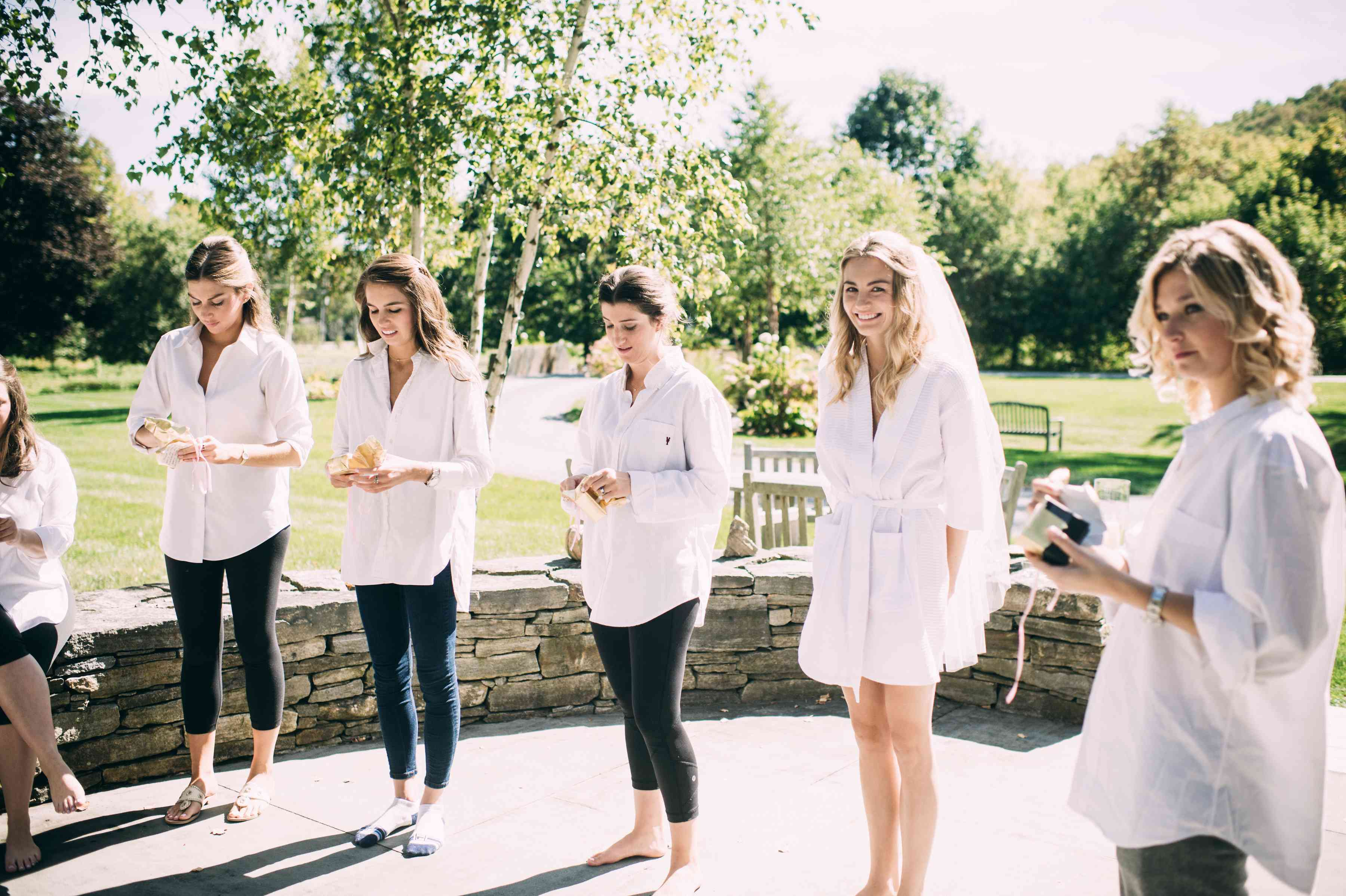 <p>bridesmaids opening their bridesmaids gifts</p><br><br>
