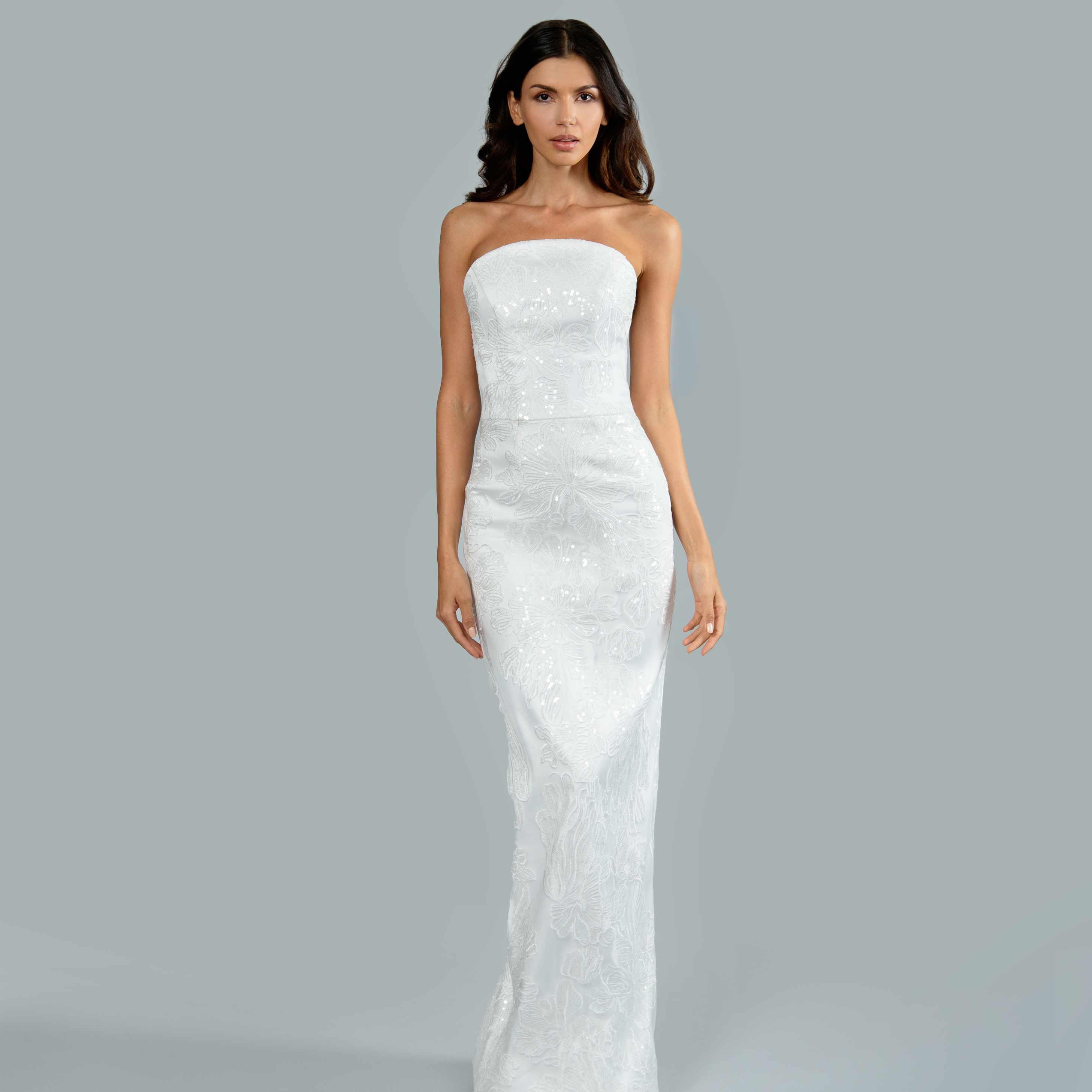 Model in strapless column wedding dress