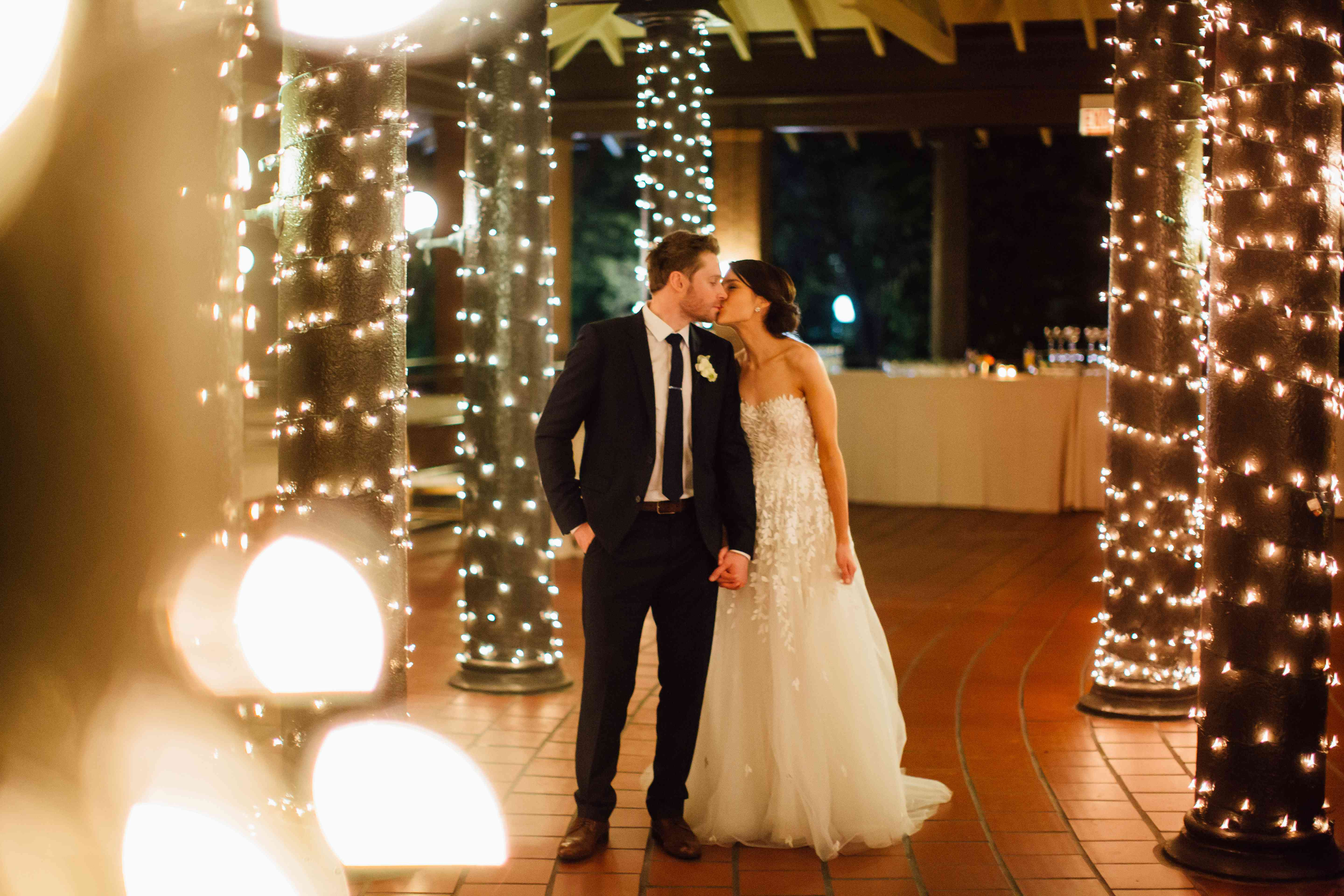 <p>Bride and Groom with String Lights</p><br><br>