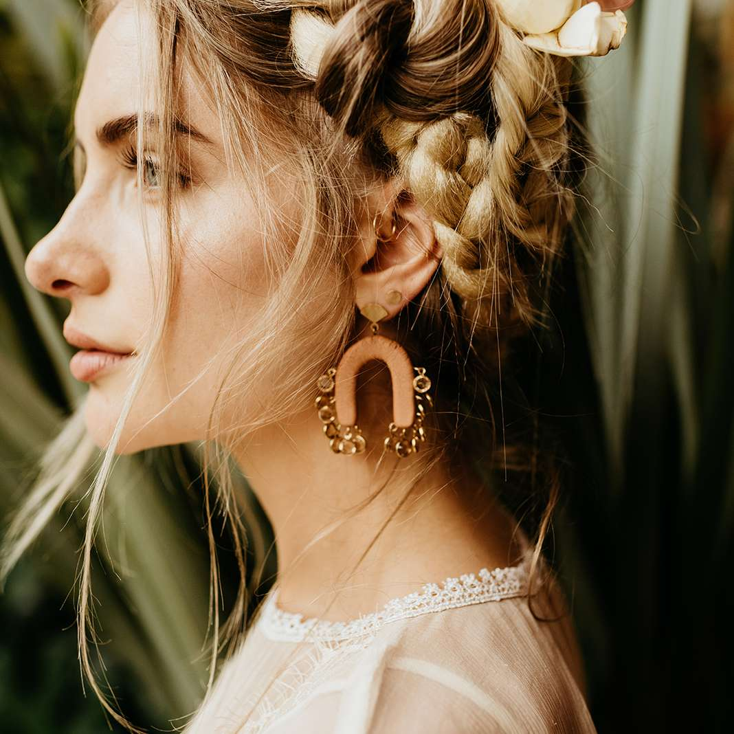 A bride with a braided up-do hairstyle