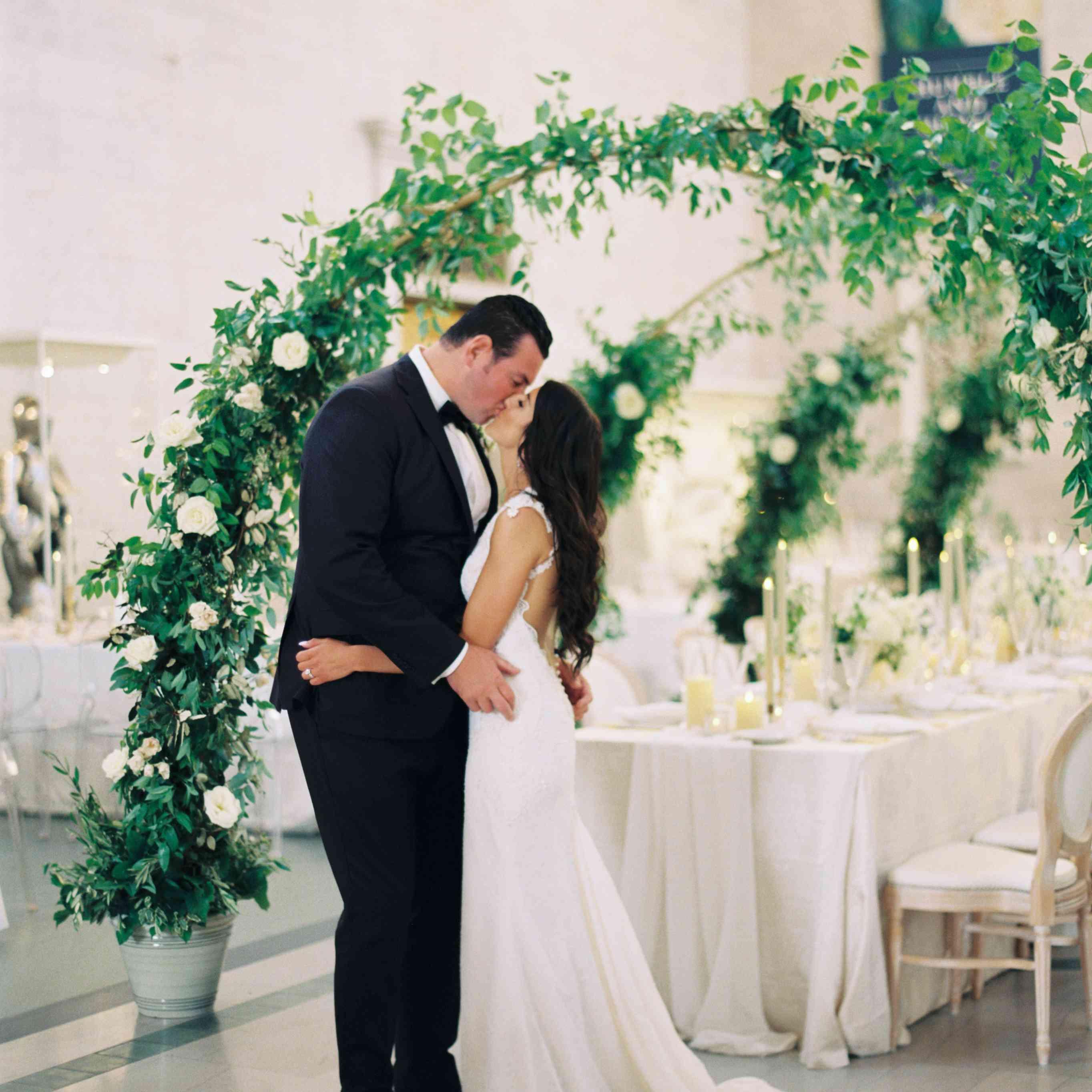 The couple shares a kiss