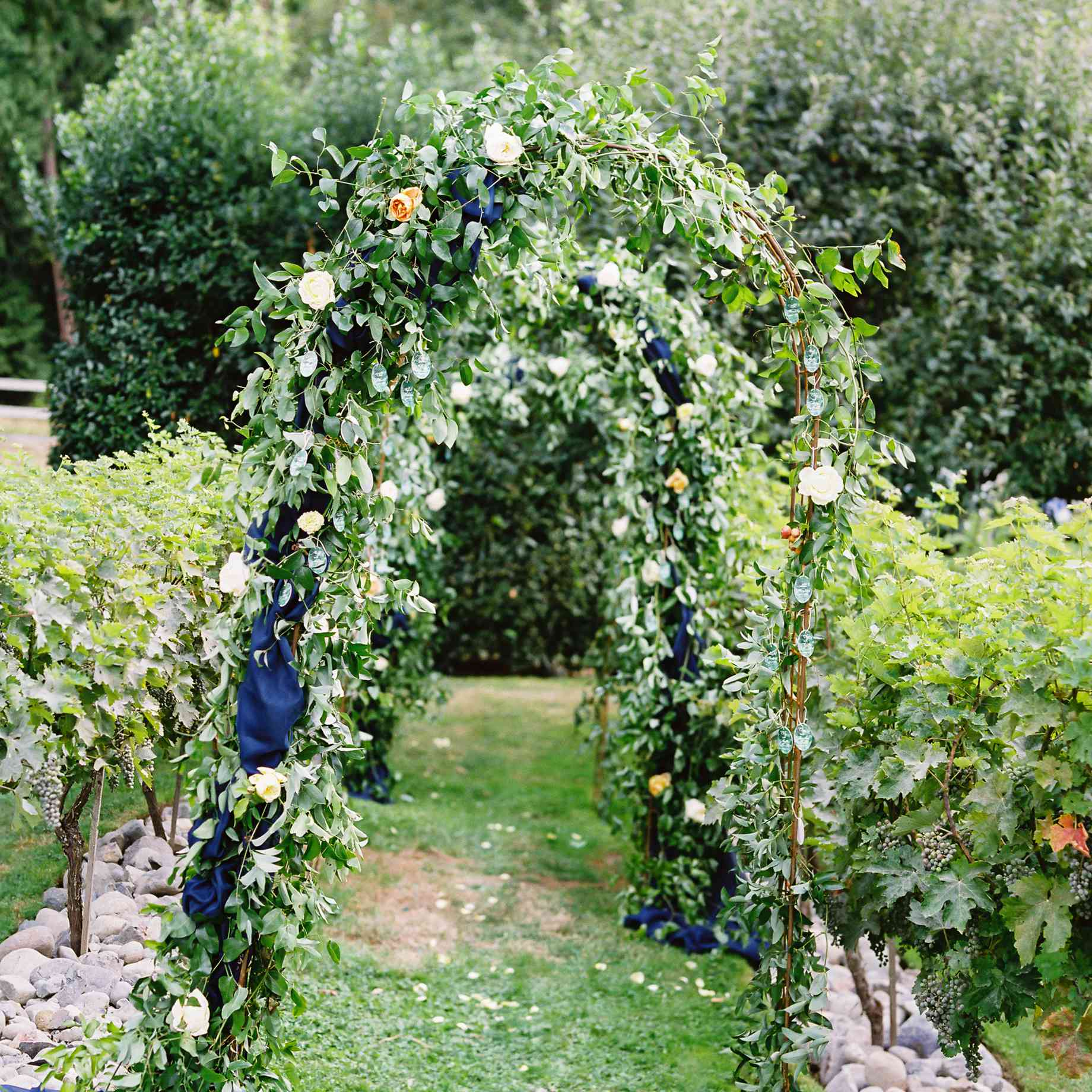Floral and greenery wedding arch