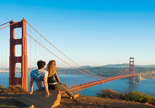 Couple looking at the Golden Gate Bridge.