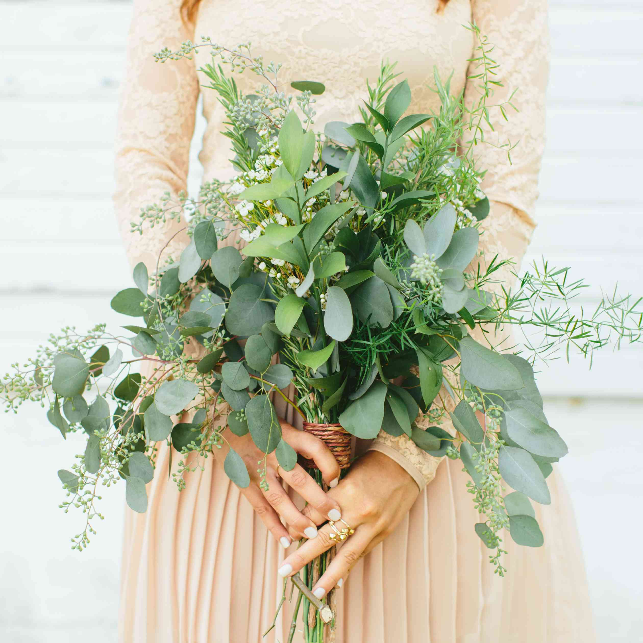 bridesmaid holding greenery bouquet
