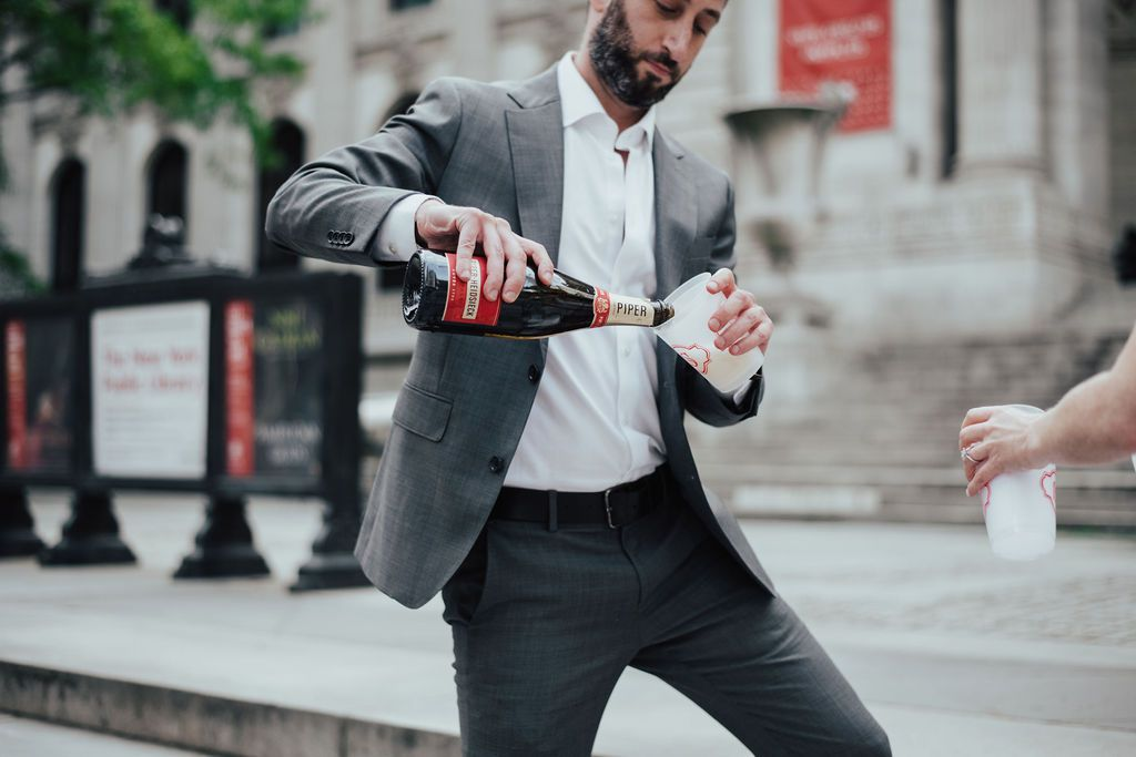 groom pouring beer