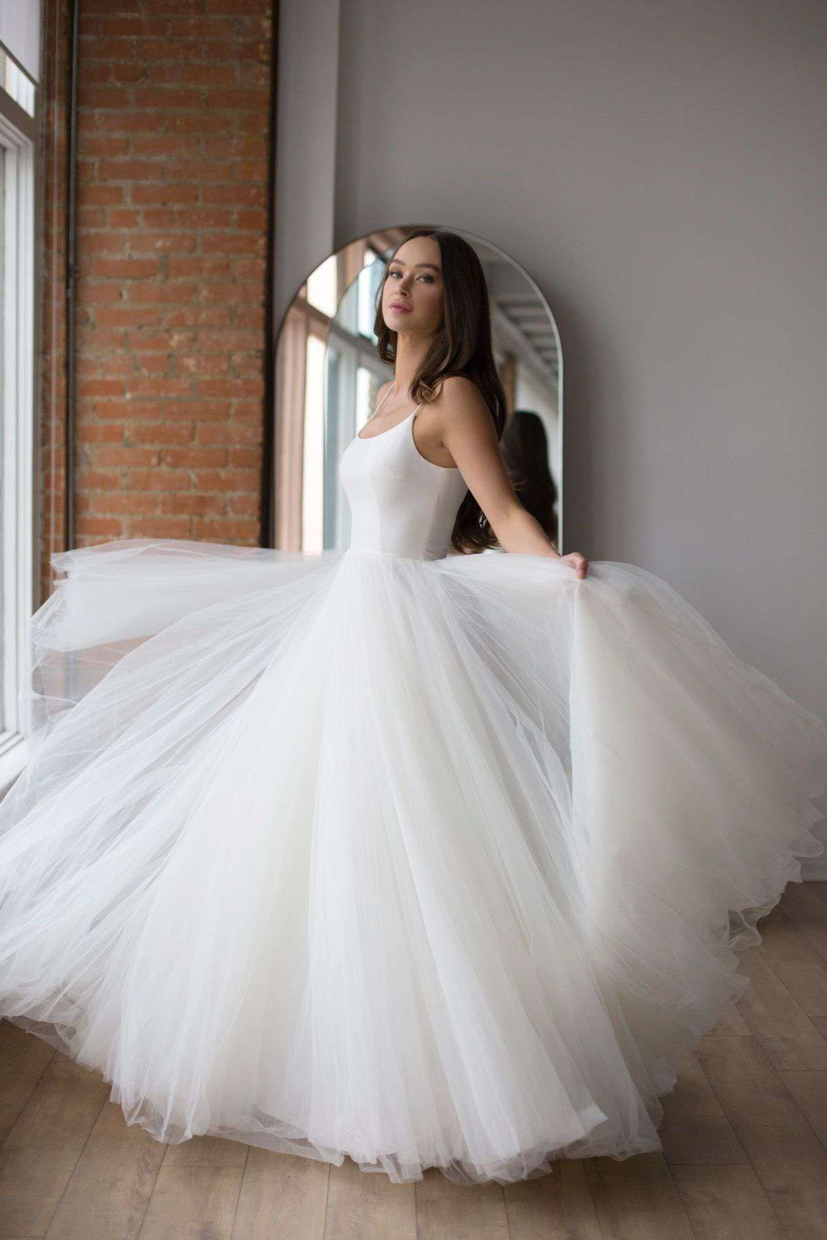 Model in ballgown with Mikado scoop neck and back bodice and soft net tulle skirt